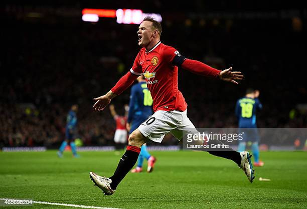 Wayne Rooney of Manchester United celebrates after scoring a goal to level the scores at 11 during the FA Cup Quarter Final match between Manchester...