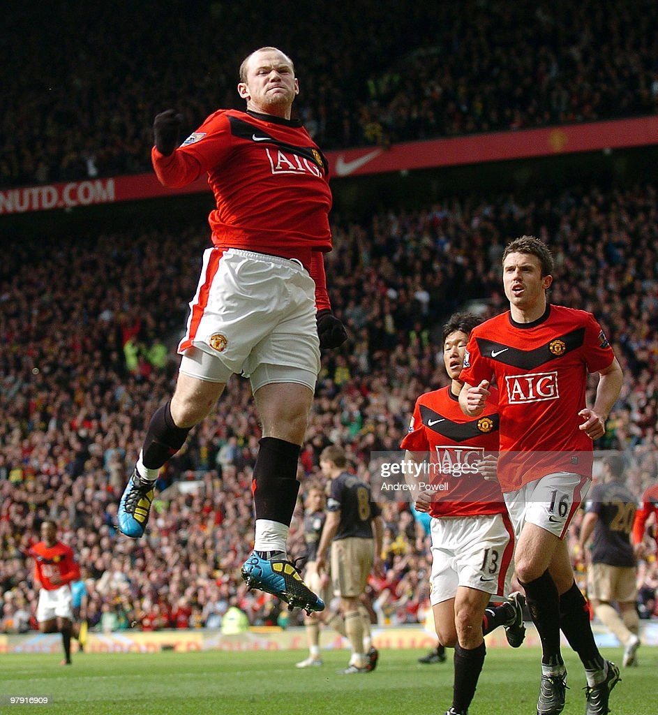 Wayne Rooney of Manchester United celebrates after scoring an equalizing goal during the Barclays Premier League match between Manchester United and Liverpool at Old Trafford on March 21, 2010 in Manchester, England.