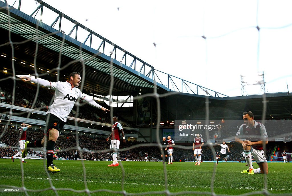 Wayne Rooney of Manchester United celebrates after scoring his team's second goal during the Barclays Premier League match between West Ham United and Manchester United at Boleyn Ground on March 22, 2014 in London, England.