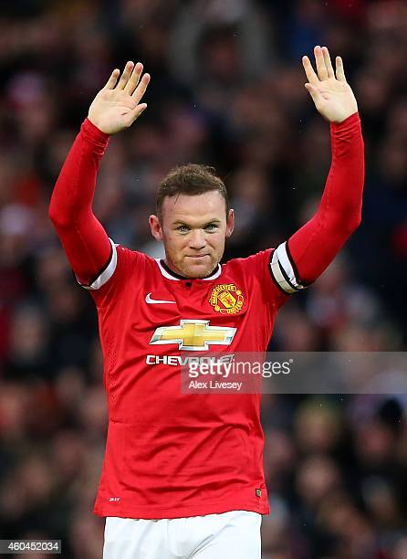 Wayne Rooney of Manchester United celebrates after scoring the first goal during the Barclays Premier League match between Manchester United and...