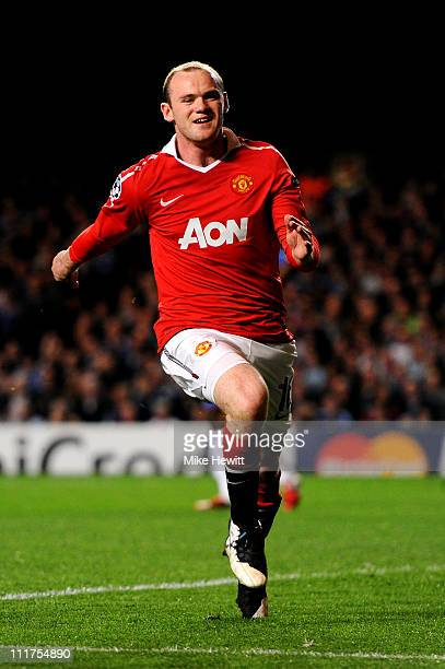 Wayne Rooney of Manchester United celebrates after scoring the opening goal during the UEFA Champions League quarter final first leg match between...