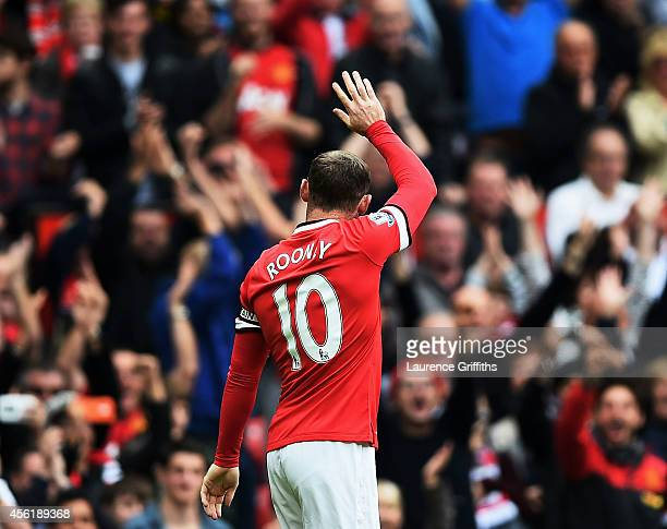 Wayne Rooney of Manchester United celebrates after scoring the opening goal during the Barclays Premier League match between Manchester United and...
