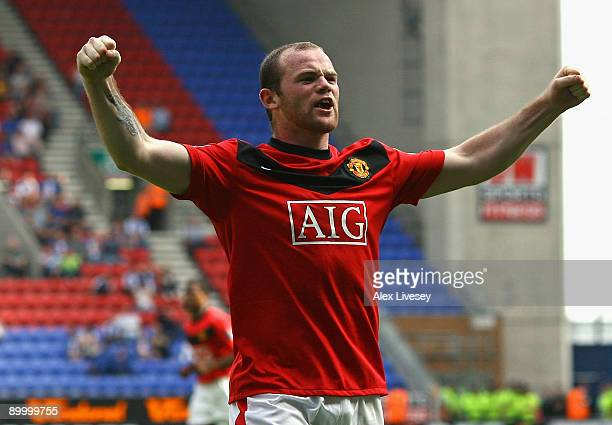 Wayne Rooney of Manchester United celebrates after scoring the opening goal during the Barclays Premier League match between Wigan Athletic and...