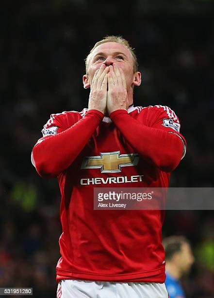 Wayne Rooney of Manchester United celebrates as he scores their first goal during the Barclays Premier League match between Manchester United and AFC...