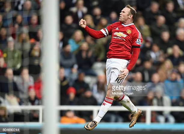 Wayne Rooney of Manchester United celebrates as he scores their third goal during the Barclays Premier League match between Newcastle United and...