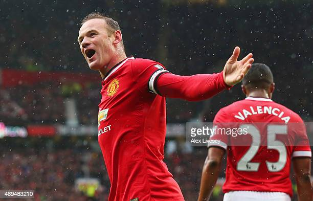 Wayne Rooney of Manchester United celebrates as Marouane Fellaini scores their second goal with a header during the Barclays Premier League match...