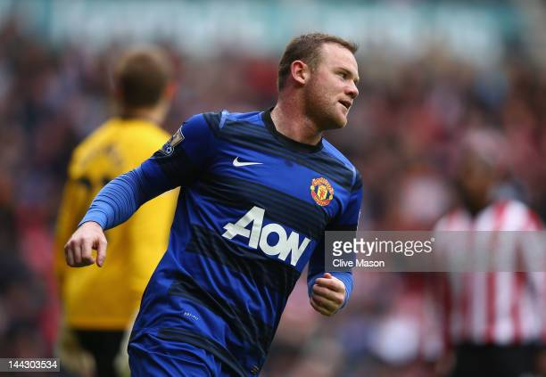 Wayne Rooney of Manchester United celebrates his goal during the Barclays Premier League match between Sunderland and Manchester United at Stadium of...
