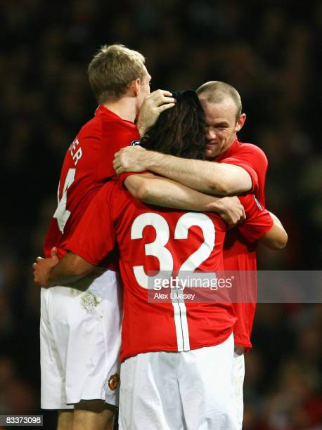 Wayne Rooney of Manchester United celebrates his goal with team mates Carlos Tevez and Darren Fletcher during the UEFA Champions League Group E match...