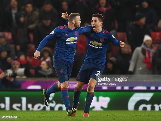 Wayne Rooney of Manchester United celebrates scoring his sides first goal with Ander Herrera of Manchester United during the Premier League match...