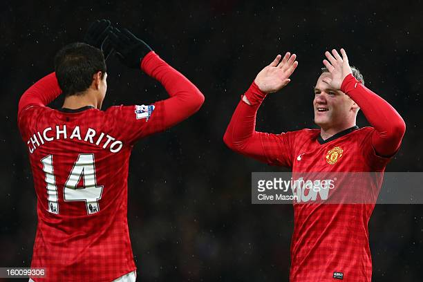 Wayne Rooney of Manchester United celebrates scoring his team's second goal with teammate Javier Hernandez during the FA Cup with Budweiser Fourth...