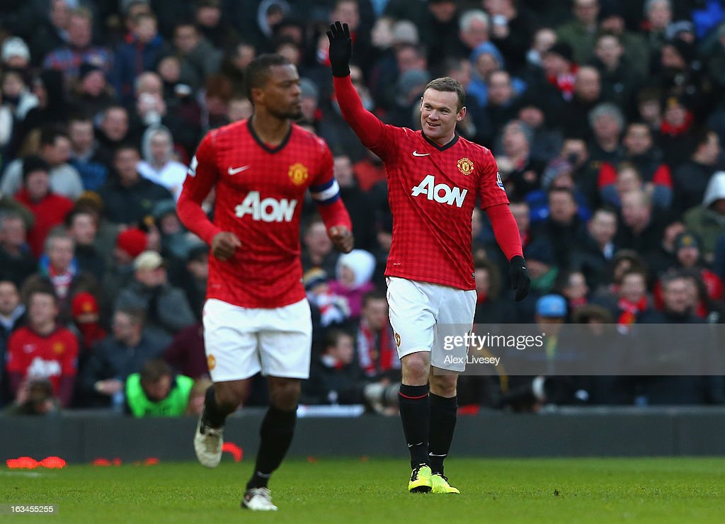 Wayne Rooney of Manchester United celebrates scoring his team's second goal during the FA Cup sponsored by Budweiser Sixth Round match between Manchester United and Chelsea at Old Trafford on March 10, 2013 in Manchester, England.