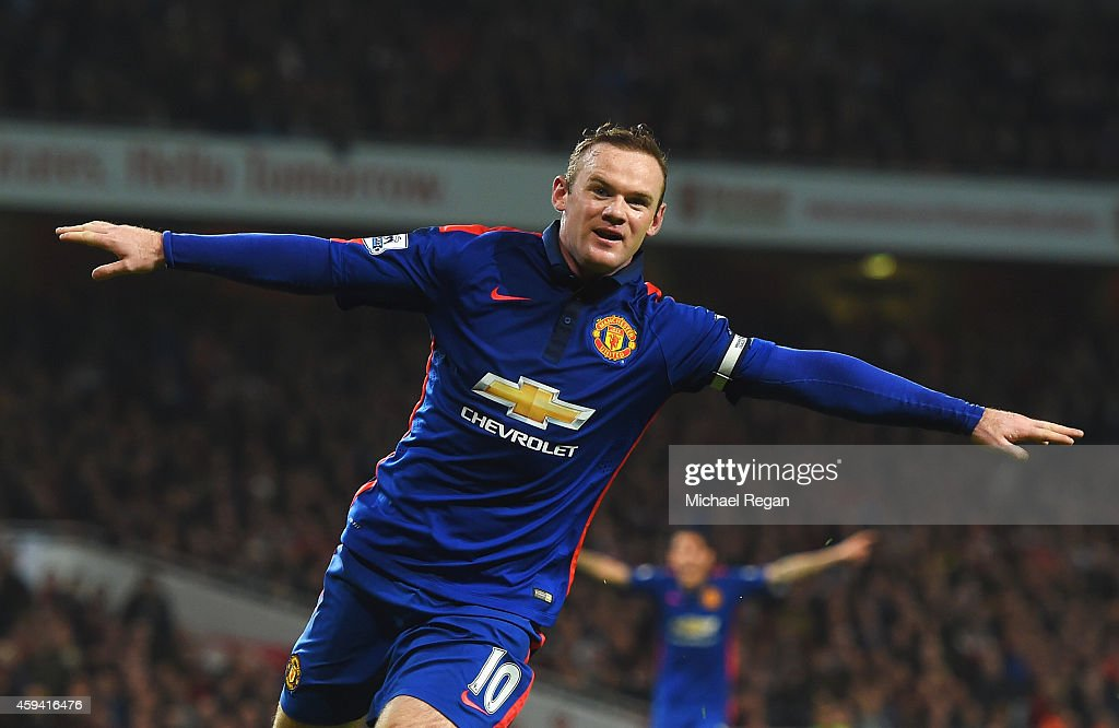 <a gi-track='captionPersonalityLinkClicked' href=/galleries/search?phrase=Wayne+Rooney&family=editorial&specificpeople=157598 ng-click='$event.stopPropagation()'>Wayne Rooney</a> of Manchester United celebrates scoring his team's second goal during the Barclays Premier League match between Arsenal and Manchester United at Emirates Stadium on November 22, 2014 in London, England.