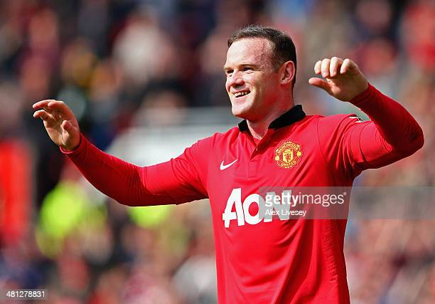 Wayne Rooney of Manchester United celebrates scoring his team's second goal from a penalty kick during the Barclays Premier League match between...