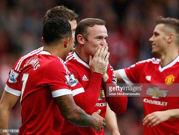 Wayne Rooney of Manchester United celebrates scoring his team's second goal with his team mates during the Barclays Premier League match between...