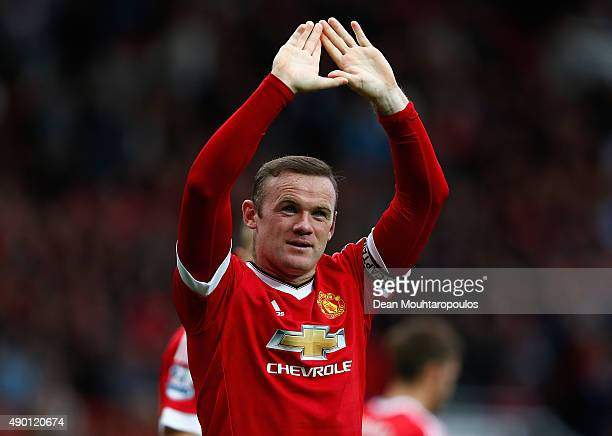 Wayne Rooney of Manchester United celebrates scoring his team's second goal during the Barclays Premier League match between Manchester United and...