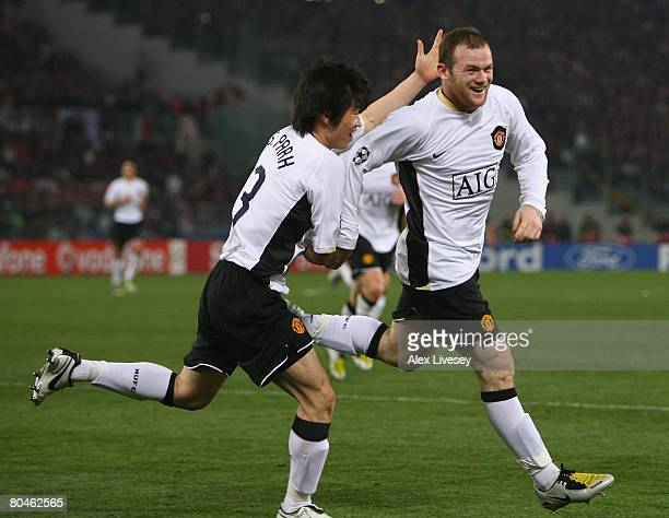 Wayne Rooney of Manchester United celebrates scoring his team's second goal with team mate JiSung Park during the UEFA Champions League Quarter Final...
