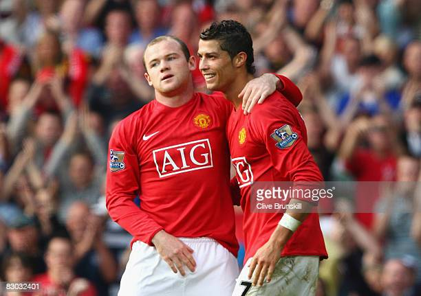 Wayne Rooney of Manchester United celebrates scoring his team's second goal with team mate Cristiano Ronaldo during the Barclays Premier League match...