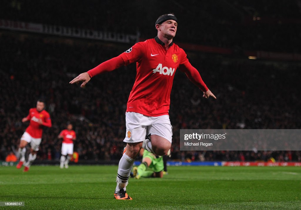 <a gi-track='captionPersonalityLinkClicked' href=/galleries/search?phrase=Wayne+Rooney&family=editorial&specificpeople=157598 ng-click='$event.stopPropagation()'>Wayne Rooney</a> of Manchester United celebrates scoring his team's third goal during the UEFA Champions League Group A match between Manchester United and Bayer Leverkusen at Old Trafford on September 17, 2013 in Manchester, England.