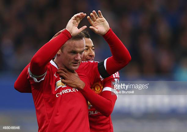 Wayne Rooney of Manchester United celebrates scoring his team's third goal with his team mate Jesse Lingard during the Barclays Premier League match...