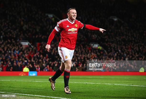 Wayne Rooney of Manchester United celebrates scoring his team's third goal during the Barclays Premier League match between Manchester United and...