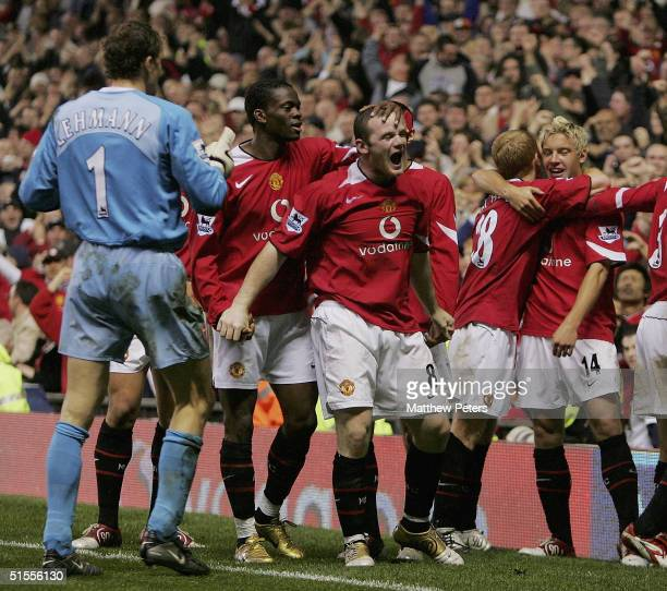 Wayne Rooney of Manchester United celebrates scoring Manchester United's second goal of the match with team mates during the Barclays Premiership...