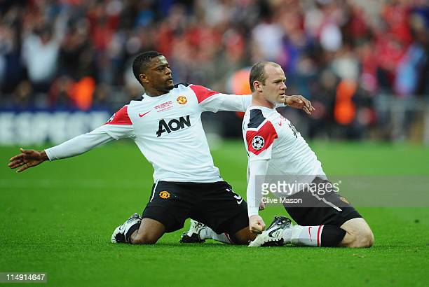 Wayne Rooney of Manchester United celebrates scoring the equalising goal with teammate Patrice Evra during the UEFA Champions League final between FC...