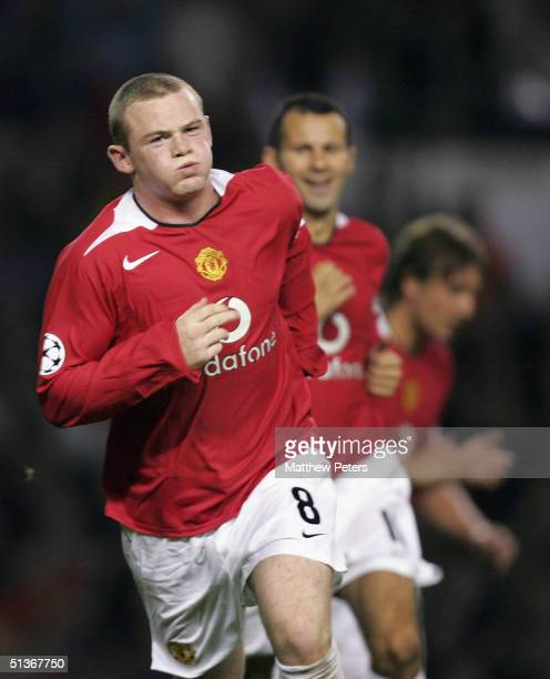 Wayne Rooney of Manchester United celebrates scoring the fifth goal and completing his debut hattrick during the UEFA Champions League match between...