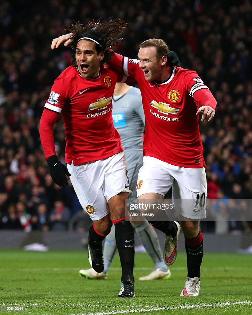 Wayne Rooney of Manchester United celebrates scoring the first goal with team-mate Radamel Falcao (L) during the Barclays Premier League match between Manchester United and Newcastle United at Old Trafford on December 26, 2014 in Manchester, England.