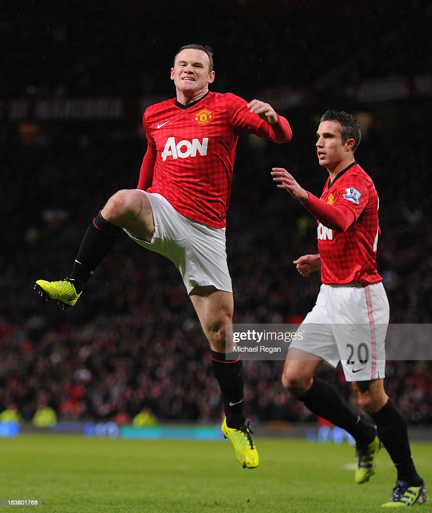 <a gi-track='captionPersonalityLinkClicked' href=/galleries/search?phrase=Wayne+Rooney&family=editorial&specificpeople=157598 ng-click='$event.stopPropagation()'>Wayne Rooney</a> of Manchester United celebrates scoring the opening goal during the Barclays Premier League match between Manchester United and Reading at Old Trafford on March 16, 2013 in Manchester, England.