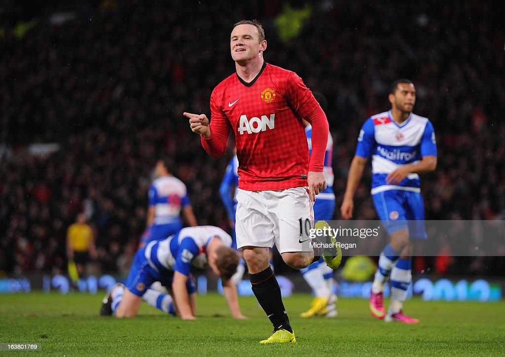 Wayne Rooney of Manchester United celebrates scoring the opening goal during the Barclays Premier League match between Manchester United and Reading...