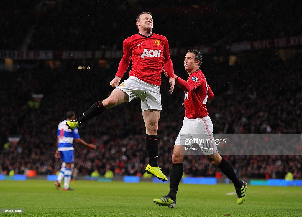 Wayne Rooney of Manchester United celebrates scoring the opening goal during the Barclays Premier League match between Manchester United and Reading at Old Trafford on March 16, 2013 in Manchester, England.