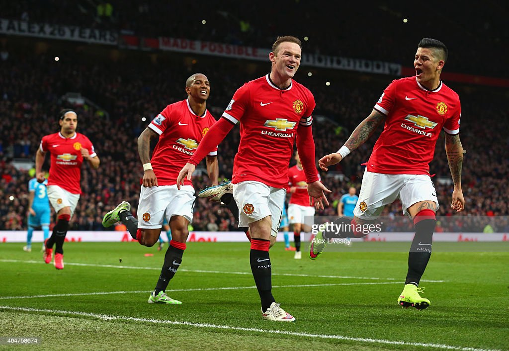 <a gi-track='captionPersonalityLinkClicked' href=/galleries/search?phrase=Wayne+Rooney&family=editorial&specificpeople=157598 ng-click='$event.stopPropagation()'>Wayne Rooney</a> of Manchester United celebrates scoring the opening goal with <a gi-track='captionPersonalityLinkClicked' href=/galleries/search?phrase=Marcos+Rojo&family=editorial&specificpeople=6740047 ng-click='$event.stopPropagation()'>Marcos Rojo</a> and <a gi-track='captionPersonalityLinkClicked' href=/galleries/search?phrase=Ashley+Young&family=editorial&specificpeople=623155 ng-click='$event.stopPropagation()'>Ashley Young</a> of Manchester United during the Barclays Premier League match between Manchester United and Sunderland at Old Trafford on February 28, 2015 in Manchester, England.