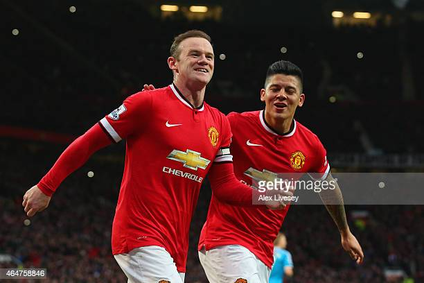 Wayne Rooney of Manchester United celebrates scoring the opening goal with Marcos Rojo of Manchester United during the Barclays Premier League match...