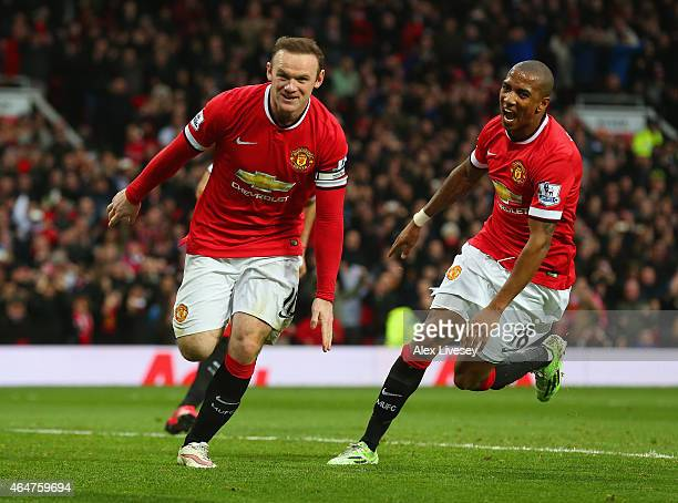 Wayne Rooney of Manchester United celebrates scoring the opening goal with Ashley Young of Manchester United during the Barclays Premier League match...