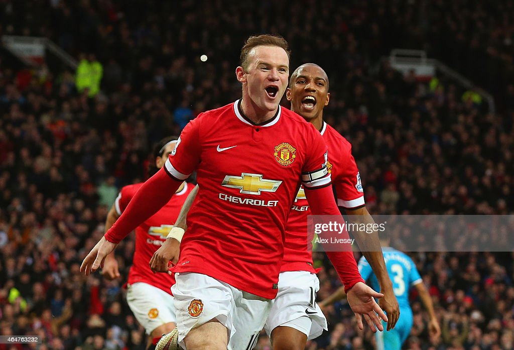 <a gi-track='captionPersonalityLinkClicked' href=/galleries/search?phrase=Wayne+Rooney&family=editorial&specificpeople=157598 ng-click='$event.stopPropagation()'>Wayne Rooney</a> of Manchester United celebrates scoring the opening goal with <a gi-track='captionPersonalityLinkClicked' href=/galleries/search?phrase=Ashley+Young&family=editorial&specificpeople=623155 ng-click='$event.stopPropagation()'>Ashley Young</a> of Manchester United during the Barclays Premier League match between Manchester United and Sunderland at Old Trafford on February 28, 2015 in Manchester, England.