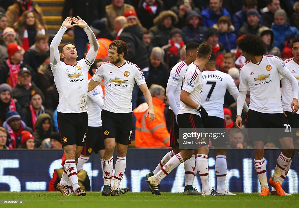 Wayne Rooney of Manchester United celebrates scoring the opening goal during the Barclays Premier League match between Liverpool and Manchester United at Anfield on January 17, 2016 in Liverpool, England.