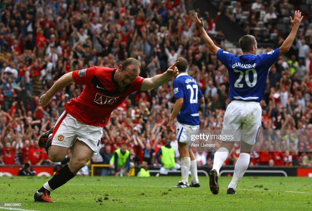 Wayne Rooney of Manchester United celebrates scoring the opening goal during the Barclays Premier League match between Manchester United and...