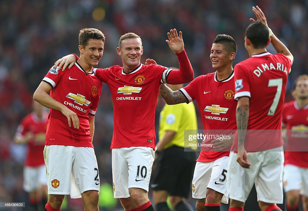 <a gi-track='captionPersonalityLinkClicked' href=/galleries/search?phrase=Wayne+Rooney&family=editorial&specificpeople=157598 ng-click='$event.stopPropagation()'>Wayne Rooney</a> of Manchester United celebrates scoring the third goal with team-mates <a gi-track='captionPersonalityLinkClicked' href=/galleries/search?phrase=Ander+Herrera&family=editorial&specificpeople=6331880 ng-click='$event.stopPropagation()'>Ander Herrera</a> (L), <a gi-track='captionPersonalityLinkClicked' href=/galleries/search?phrase=Marcos+Rojo&family=editorial&specificpeople=6740047 ng-click='$event.stopPropagation()'>Marcos Rojo</a> and <a gi-track='captionPersonalityLinkClicked' href=/galleries/search?phrase=Angel+Di+Maria&family=editorial&specificpeople=4110691 ng-click='$event.stopPropagation()'>Angel Di Maria</a> during the Barclays Premier League match between Manchester United and Queens Park Rangers at Old Trafford on September 14, 2014 in Manchester, England.