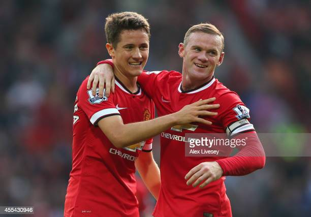 Wayne Rooney of Manchester United celebrates scoring the third goal with teammate Ander Herrera during the Barclays Premier League match between...