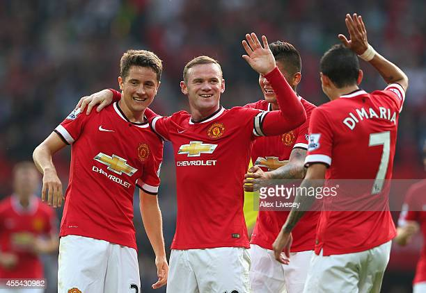 Wayne Rooney of Manchester United celebrates scoring the third goal with teammates Ander Herrera Marcos Rojo and Angel Di Maria during the Barclays...