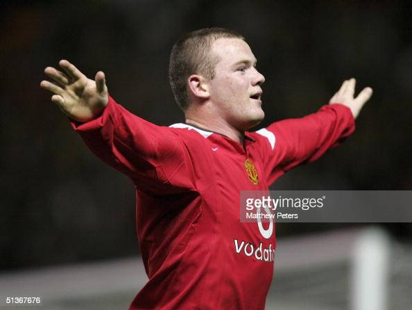 Wayne Rooney of Manchester United celebrates scoring the third goal during the UEFA Champions League match between Manchester United and Fenerbahce...