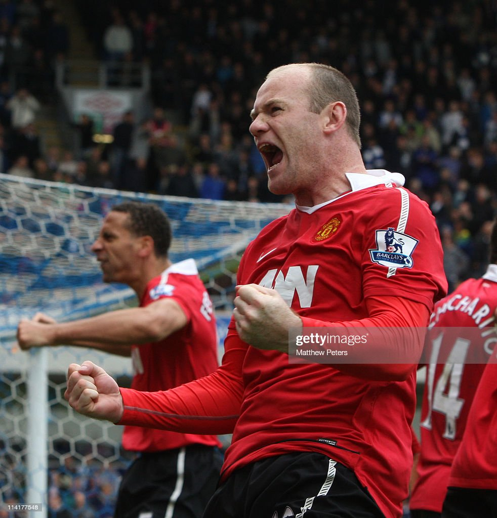 Wayne Rooney of Manchester United celebrates scoring their first goal during the Barclays Premier League match between Blackburn Rovers and Manchester United at Ewood Park on May 14, 2011 in Blackburn, England.