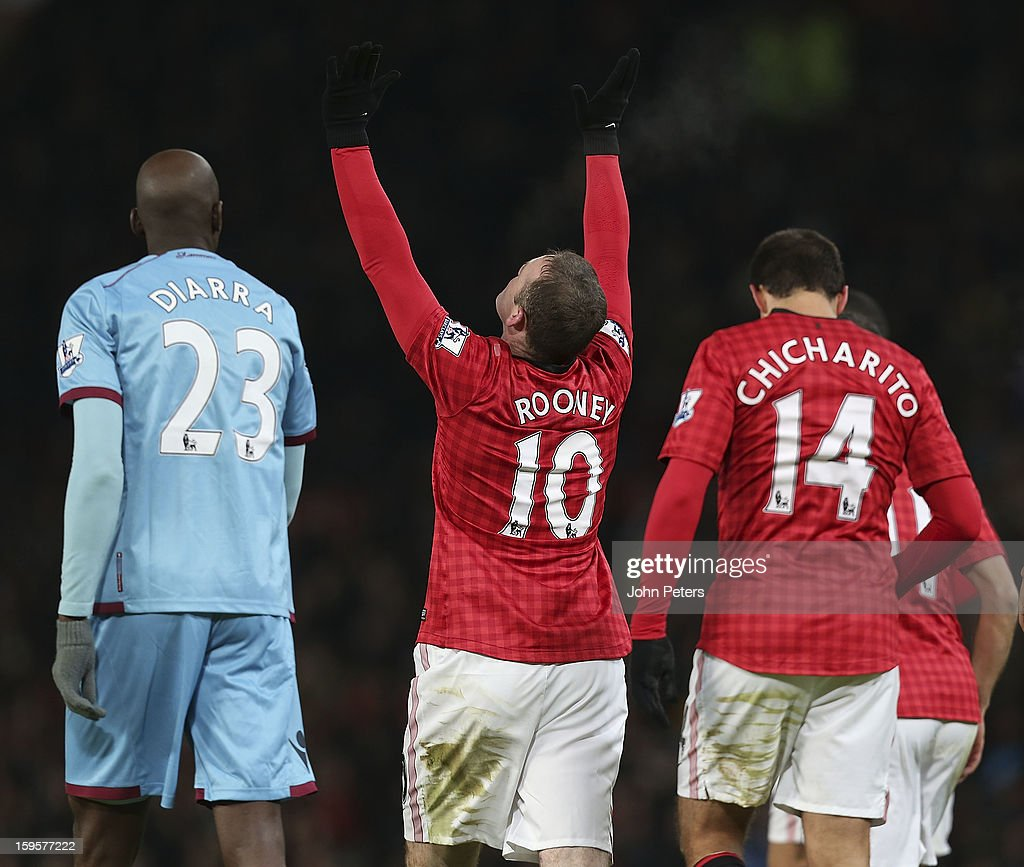 <a gi-track='captionPersonalityLinkClicked' href=/galleries/search?phrase=Wayne+Rooney&family=editorial&specificpeople=157598 ng-click='$event.stopPropagation()'>Wayne Rooney</a> of Manchester United celebrates scoring their first goal during the FA Cup Third Round Replay match between Manchester United and West Ham United at Old Trafford on January 16, 2013 in Manchester, England.