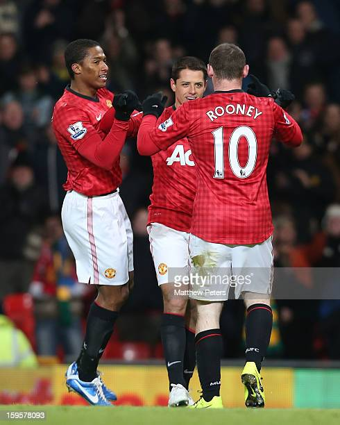 Wayne Rooney of Manchester United celebrates scoring their first goal during the FA Cup Third Round Replay between Manchester United and West Ham...