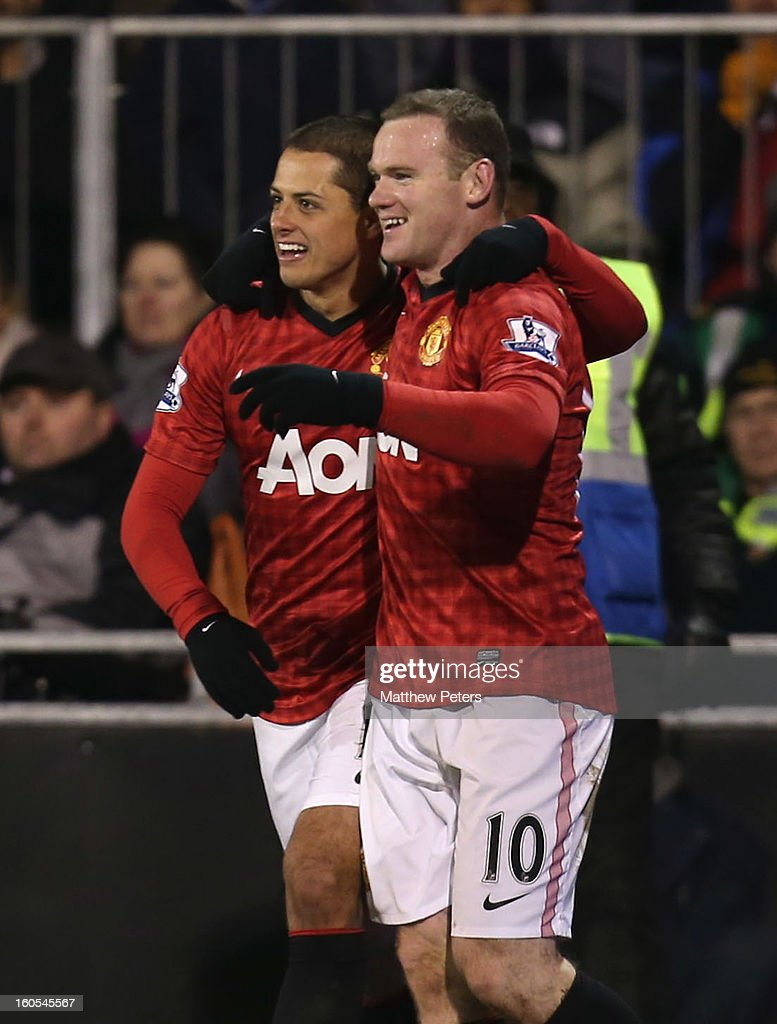 <a gi-track='captionPersonalityLinkClicked' href=/galleries/search?phrase=Wayne+Rooney&family=editorial&specificpeople=157598 ng-click='$event.stopPropagation()'>Wayne Rooney</a> of Manchester United (L) celebrates scoring their first goal during the Barclays Premier League match between Fulham and Manchester United at Craven Cottage on February 2, 2013 in London, England.