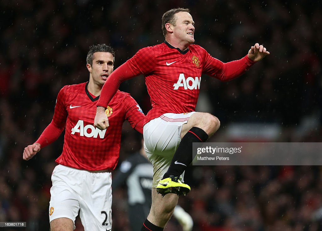 <a gi-track='captionPersonalityLinkClicked' href=/galleries/search?phrase=Wayne+Rooney&family=editorial&specificpeople=157598 ng-click='$event.stopPropagation()'>Wayne Rooney</a> of Manchester United celebrates scoring their first goal during the Barclays Premier League match between Manchester United and Reading at Old Trafford on March 16, 2013 in Manchester, England.