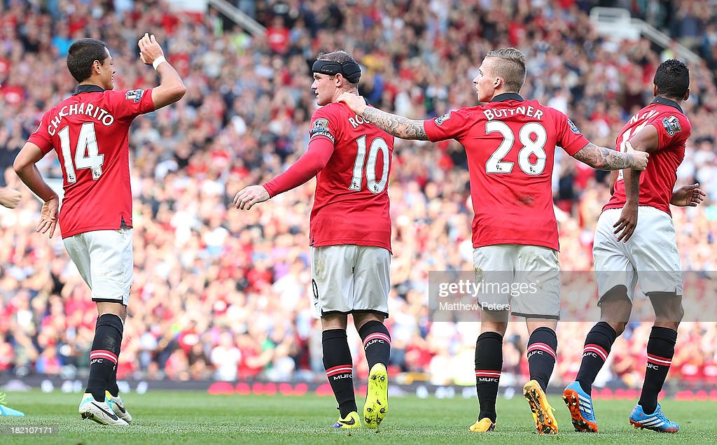 <a gi-track='captionPersonalityLinkClicked' href=/galleries/search?phrase=Wayne+Rooney&family=editorial&specificpeople=157598 ng-click='$event.stopPropagation()'>Wayne Rooney</a> (C) of Manchester United celebrates scoring their first goal during the Barclays Premier League match between Manchester United and West Bromwich Albion at Old Trafford on September 28, 2013 in Manchester, England.
