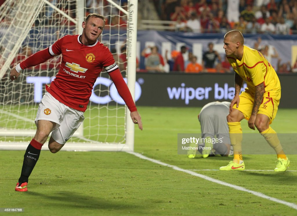 <a gi-track='captionPersonalityLinkClicked' href=/galleries/search?phrase=Wayne+Rooney&family=editorial&specificpeople=157598 ng-click='$event.stopPropagation()'>Wayne Rooney</a> of Manchester United celebrates scoring their first goal during the pre-season friendly match between Manchester United and Liverpool at Sun Life Stadium on August 4, 2014 in Miami Gardens, Florida.