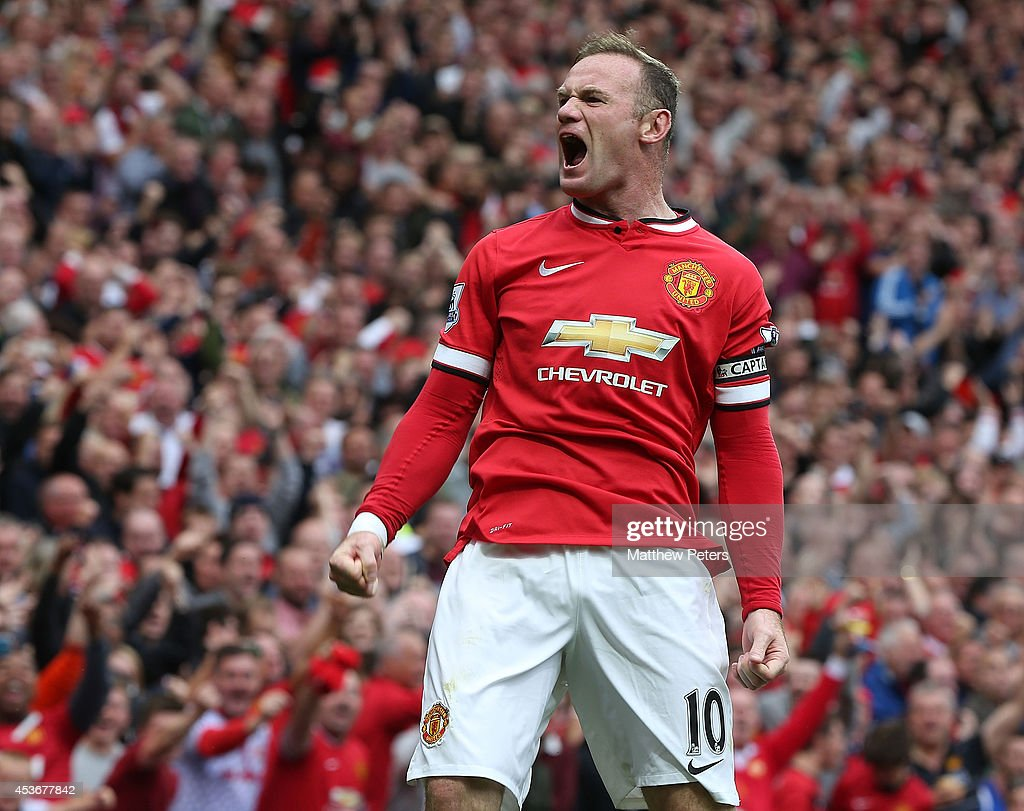 <a gi-track='captionPersonalityLinkClicked' href=/galleries/search?phrase=Wayne+Rooney&family=editorial&specificpeople=157598 ng-click='$event.stopPropagation()'>Wayne Rooney</a> of Manchester United celebrates scoring their first goal during the Barclays Premier League match between Manchester United and Swansea City at Old Trafford on August 16, 2014 in Manchester, England.