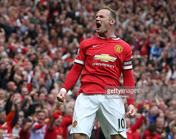 Wayne Rooney of Manchester United celebrates scoring their first goal during the Barclays Premier League match between Manchester United and Swansea...